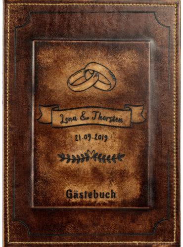 Personalisiertes Hochzeitsbuch mit ineinander verschlungenen Ringen und Ranken